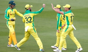 Australia's Marcus Stoinis (right) celebrates with team-mates after catching out England's Dawid Malan.