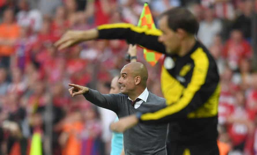 Pep Guardiola and Thomas Tuchel during Bayern Munich's win over Borussia Dortmund on penalties in the 2016 German Cup final