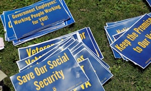 Signs on the ground during a rally of federal employees to protest proposed cuts in federal funding in Philadelphia, Pennsylvania, on 22 June 2017.