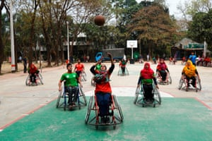 Wheelchair basketball players including men and women play during a friendly match jointly organised by the Centre for Rehabilitation of the Paralysed and the International Committee of the Red Cross