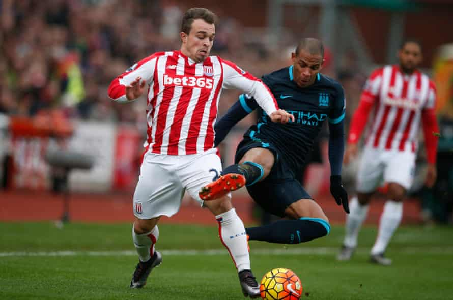 Stoke's Xherdan Shaqiri gets the better of Manchester City's Fernando at the Britannia Stadium.