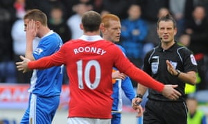 Wayne Rooney pleads innocence to Mark Clattenburg after he had clashed with Wigan's James McCarthy in 2011