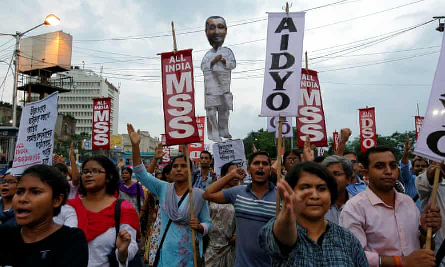 People shout slogans as they carry an effigy depicting Kuldeep Singh Sengar during a protest in Kolkata, India, on 31 July 2019.