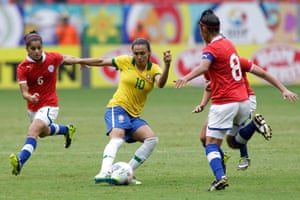 Brazil's Marta, center, fights for the ball against Chile's Daniela Pardo Moreno, right, and York Arriagada Bustos