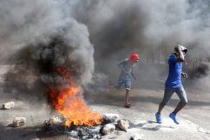 Demonstrators protest against former government officials accused of misusing Petrocaribe funds in Port-au-Prince, Haiti.