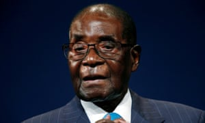 Robert Mugabe leaves the stage after participating in a discussion at the World Economic Forum on Africa in Durban in May.