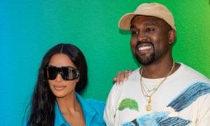 Kim Kardashian West and Kanye West at the spring/summer Louis Vuitton show at Paris men's fashion week, 21 June.