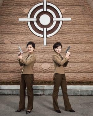 Kim Hyang and Kim Ju Hyang pose in the Meari shooting range (June 2018)
