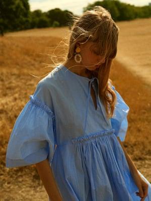 Light blue dress, £430, Henrik Vibskov at couvertureandthegarbstore.com. Earrings, £215, completedworks.com