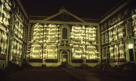 'I Must Learn to Know My Place' projected on building's facade