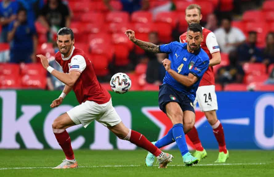 Leonardo Spinazzola passes the ball under pressure from Austria's Florian Grillitsch during Italy's last-16 victory.
