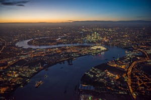 2300ft over Greenwich Peninsula at night. The O2 lit up on the peninsula and Canary Wharf and the City of London in the distance