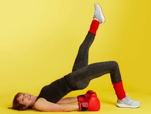 Zoe Williams in boxing gloves doing leg lift