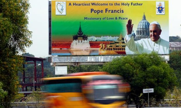 A roadside billboard welcomes Pope Francis to Myanmar