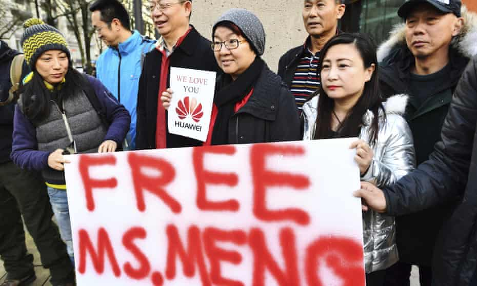 People demonstrate outside Vancouver courthouse prior to the bail hearing for Meng Wanzhou, Huawei's chief financial officer on Monday.