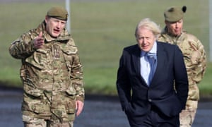 British Prime Minister Boris Johnson visits Joint Helicopter Command Flying Station Aldergrove, Northern Ireland, March, 12, 2021.