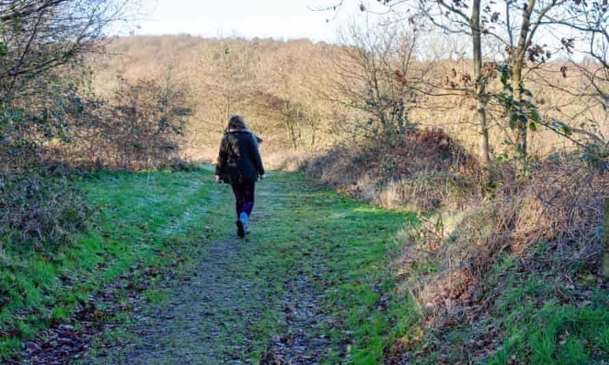 A woman walking in Snipe Dales Nature Reserve,