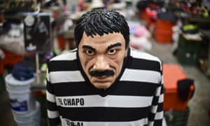 A costume and a mask representing drug trafficker Joaquin Guzman, aka 'El Chapo, at a factory in Jiutepec in Mexico.