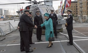 Queen Elizabeth on deck during her visit to HMS Sutherland. The frigate is due to sail through the South China Sea.