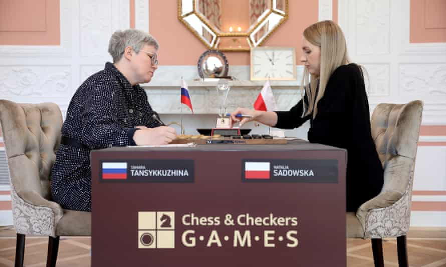 Russia's Tamara Tansykkuzhina and Poland's Natalia Sadowska during a match on 27 April, before the Russian flag was snatched.