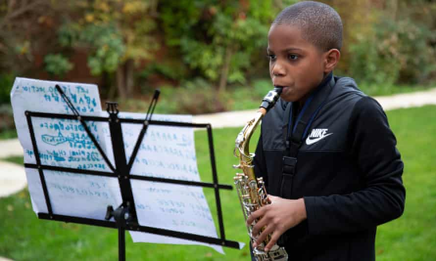 Eight-year-old Solomon Dubois plays his saxophone