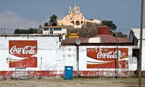 The church of Nuestra Senora de los Remedios in Cholula, Mexico, and signs for Coca Cola