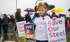 Steel workers and their families march through Motherwell, Scotland