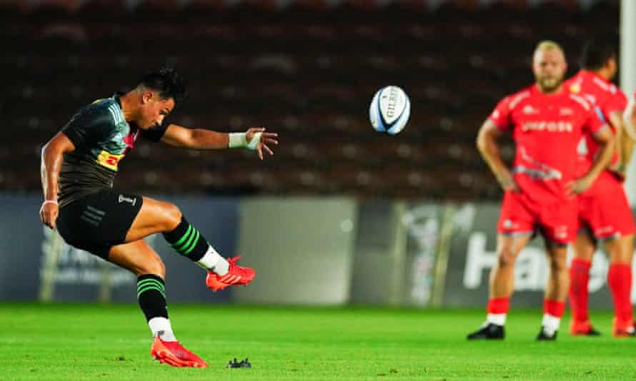 Marcus Smith of Harlequins kicks his side to an early 6-0 lead over Sale
