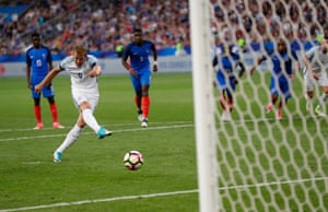 Harry Kane fires the ball straight down the middle.
