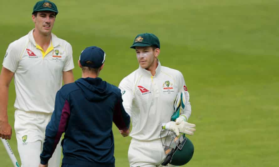 Australia's Tim Paine, right, shakes hands with Joe Root.