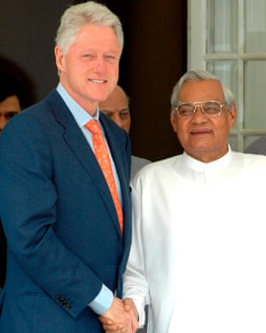 Atal Bihari Vajpayee shakes hands with Bill Clinton in 2005 during a visit by the former US president to New Delhi.