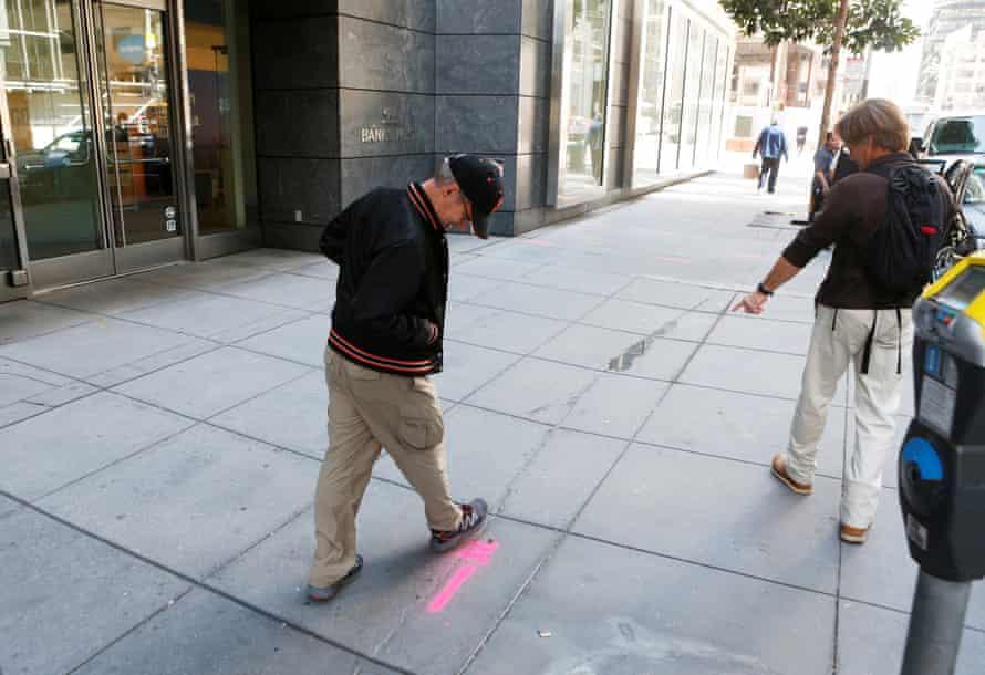 Pedestrians inspect cracks near the sinking Millennium tower in San Francisco in 2016.