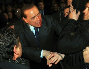December 2009: Berlusconi is injured after an attacker hurled a statuette at him at the end of a rally in Milan
