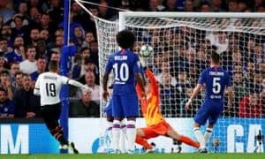 Rodrigo's shot bounces over Kepa Arrizabalaga and into the net to give Valencia the lead.