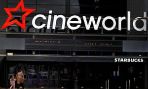 People enter a Cineworld cinema in October near Manchester.