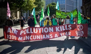 Protesters in Manchester this month hold a banner highlighting pollution-related deaths.