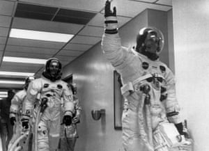 neil armstrong leads buzz aldrin and michael collins out to apollo 11