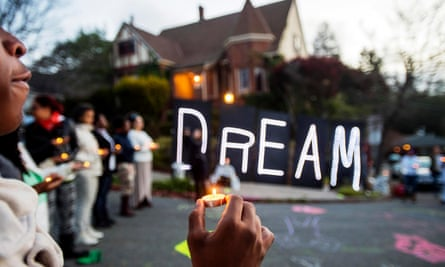 Protesters gather last year near illuminated letters spelling dream outside a house which they identified as the residence of Oakland Mayor Libby Schaaf.