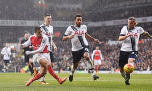Alexis Sánchez, left, shoots to score Arsenal's second goal that gets them back on level pegging.