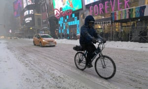 A man cycles through the snow in Times Square in New York last month.