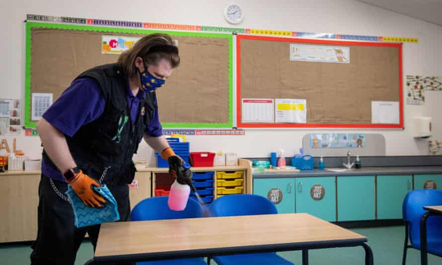 A man disinfects a classroom near Norwich ahead of the new school term.