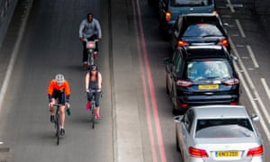 Cyclists using the TFL Cycle Superhighway in Upper Thames Street, London