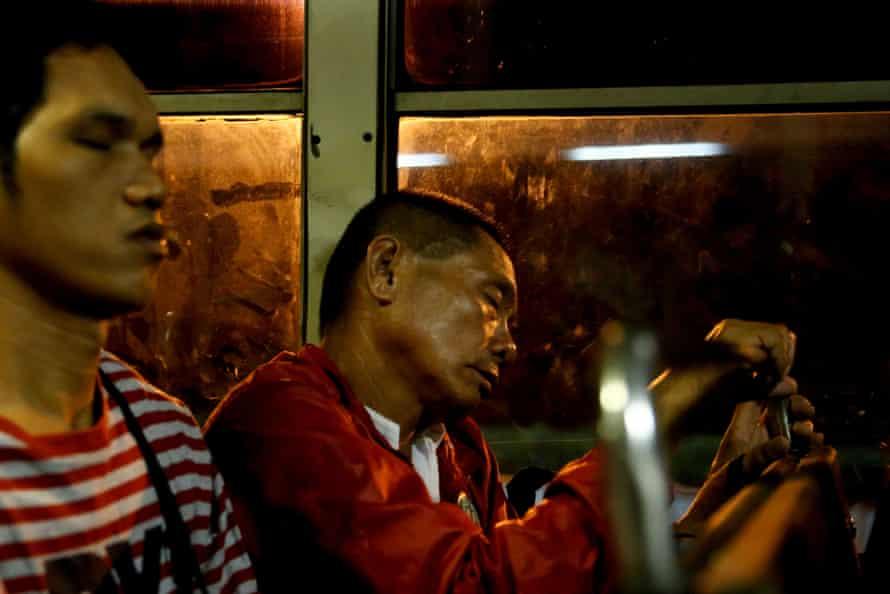 Alejandro Galasao, 58, street sweeper, sleeps on a bus