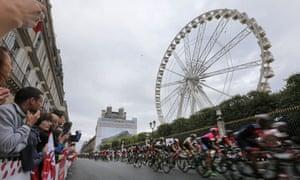 Spectators watch as the pack rides past the Big Wheel at the Place de la Concorde in Paris.