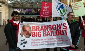 Campaigners stage a protest at King's Cross station in London against the government bailout of Virgin Trains East Coast rail franchise on 18 January 2018