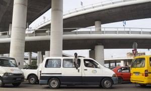 A van drives beneath the recently constructed Henri Konan Bedie bridge in Abidjan