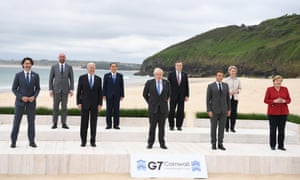 The G7 leaders pose during the 'family photo' on the first day of the summit in Carbis Bay, Cornwall.