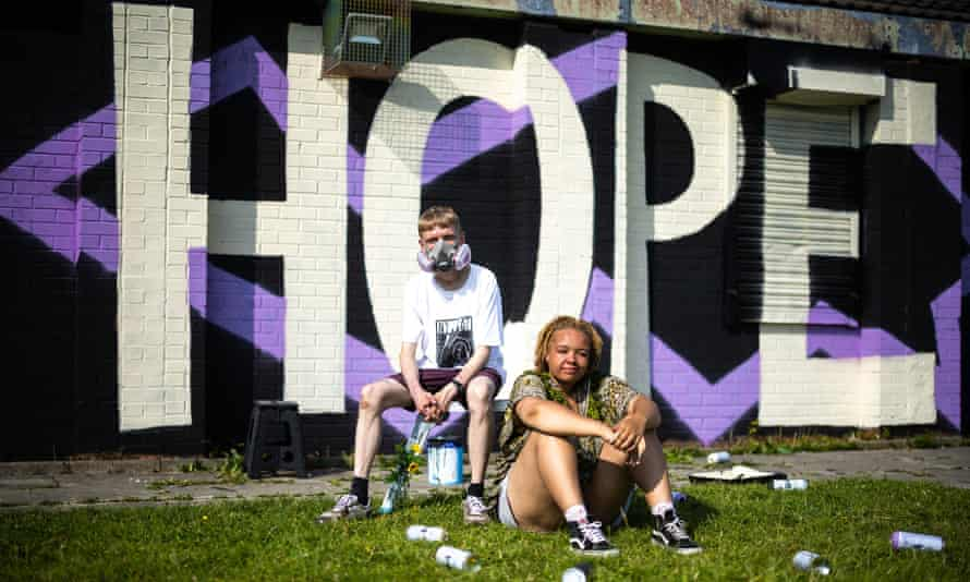 Oskar with a K and Katie Jones in front of the Hope Beats Hate mural.