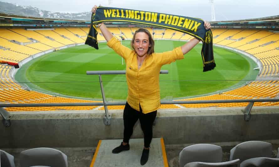 Annalie Longo poses with a Wellington Phoenix scarf