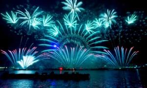 Fireworks illuminate London's Thames river.